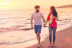 Happy young romantic couple in love have fun on beautiful beach at beautiful summer day.  Royalty Free Stock Photo