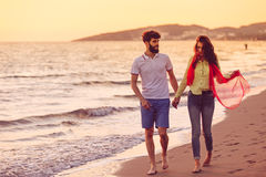 Happy young romantic couple in love have fun on beautiful beach at beautiful summer day.  Stock Photo