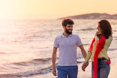 Happy young romantic couple in love have fun on beautiful beach at beautiful summer day Stock Photography