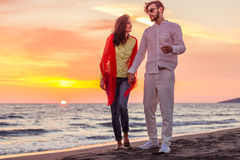 Happy young romantic couple in love have fun on beautiful beach at beautiful summer day Royalty Free Stock Image