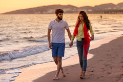 Happy young romantic couple in love have fun on beautiful beach at beautiful summer day.  Stock Images