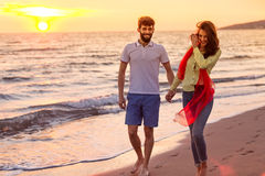 Happy young romantic couple in love have fun on beautiful beach at beautiful summer day Royalty Free Stock Photos