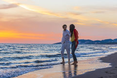Happy young romantic couple in love have fun on beautiful beach at beautiful summer day.  Royalty Free Stock Image