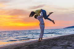 Happy young romantic couple in love have fun on beautiful beach at beautiful summer day.  Royalty Free Stock Photos