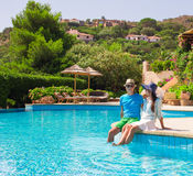 Happy young romantic couple relaxing near swimming Stock Photography