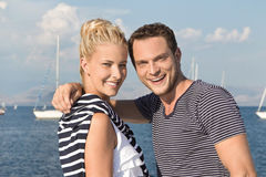 Happy young sailor couple on the sea - vacancies on a sail boat. Stock Photography
