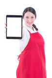 Happy young sales clerk holding modern tablet. With empty display in market store isolated on white Stock Photo