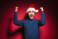Happy young santa man celebrating Stock Images