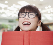 Happy Young School Girl in Glasses with Open Book Royalty Free Stock Photography