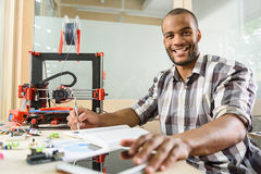 Happy young scientist glad about 3d printing Royalty Free Stock Image