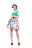 Happy Young Shopper. Fashion Style. Happy Young Shopper in Contrast Flower Print Skirt. Movement royalty free stock images