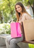 Happy young shopper. Oudoors with colorful shopping bags royalty free stock photos