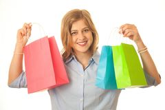Happy Young Shopper with her Shopping Bags. Close up of a young woman looking very happy as she holds her shopping bags Royalty Free Stock Photo