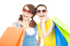 Happy young sisters holding shopping bags Stock Image