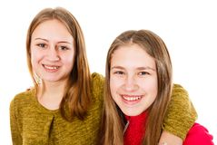 Happy young sisters. Portrait photo of happy young sisters on isolated white background Stock Photography