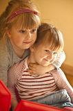 Happy young sisters. Portrait of happy young preschool sisters hugging or embracing stock photos