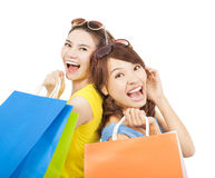Happy young sisters with shopping bags Royalty Free Stock Images