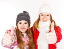 Happy young sisters showing thumbs up. Portrait photo of happy young sisters showing thumbs up Royalty Free Stock Images