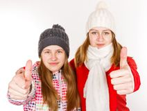 Happy young sisters showing thumbs up. Portrait photo of happy young sisters showing thumbs up Royalty Free Stock Photography