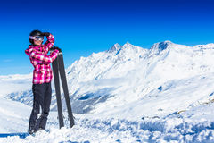 Happy young skier in mountains. Royalty Free Stock Images