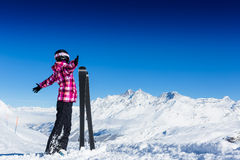 Happy young skier in mountains Stock Photography