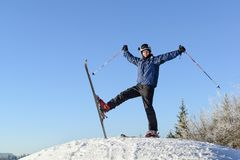 Happy skier on the top of a mountain royalty free stock photography