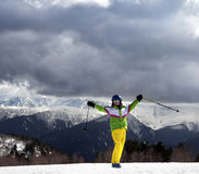 Happy young skier with ski poles in sun mountains Royalty Free Stock Photos