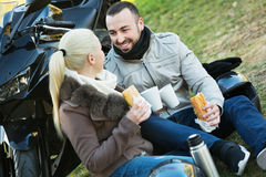 Happy young smiling couple having picnic with coffee Stock Photos