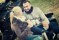 Happy young smiling couple having picnic with coffee Royalty Free Stock Photography