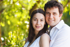 Happy young smiling couple in summer day Royalty Free Stock Image