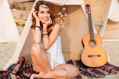 Happy young smiling girl at the campsite. Posing at the beach royalty free stock photography