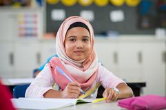 Young girl in hijab at school