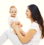 Happy young smiling mother playing with baby Royalty Free Stock Photo