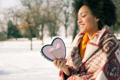 Happy young smiling woman with big heart in winter day Stock Images