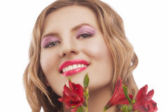 Happy young smiling woman with bunch of flowers Royalty Free Stock Images