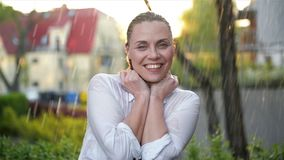 Happy Young Smiling Woman Having Fun In Rainy Weather. Cheerful Lady Has Wet Hair In Summer Park. stock footage