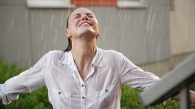 Happy Young Smiling Woman Having Fun In Rainy Weather. Cheerful Lady Has Wet Hair In Summer Park. stock video