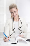 Happy young smiling woman working in a bank or insurance Stock Images