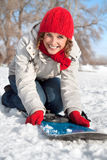 Happy young snowboard girl  on the snow day Royalty Free Stock Photography
