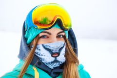 Happy young snowboarder girl in snowboard goggles. Stock Photos