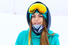 Happy young snowboarder girl in snowboard goggles. Royalty Free Stock Photos