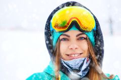 Happy young snowboarder girl in snowboard goggles. Stock Photo