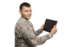 Hispanic soldier holding a tablet Royalty Free Stock Image