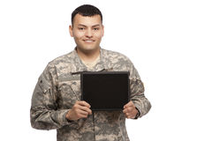Hispanic soldier showing tablet Stock Photos