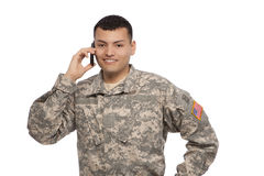 Soldier on smart phone. Happy young soldier talking on a cell phone Royalty Free Stock Image