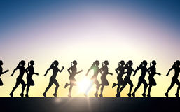 Happy young sports woman running outdoors Royalty Free Stock Image