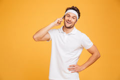 Happy young sportsman talking on mobile phone Stock Photo