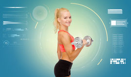 Happy young sporty woman exercising with dumbbell Stock Photos