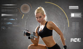 Happy young sporty woman exercising with dumbbell Stock Image