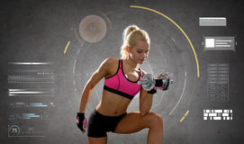 Happy young sporty woman exercising with dumbbell Royalty Free Stock Images